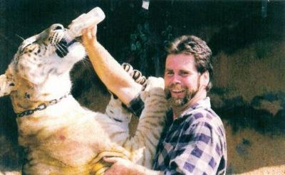 Thomas Dee Huskey Bottle Feeding a Liger